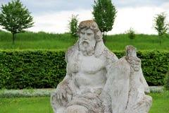 Neptune. Big statue Neptune from stone in spring garden Stock Image