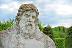 Neptune. Big statue Neptune from stone in spring garden Stock Images