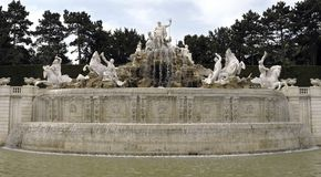 Neptune fountain. Scenic view of Neptune fountain and sculptures in park Stock Photos