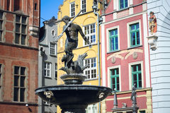 Neptune Fountain on the background of colorful European houses in Gdansk, Poland Stock Photo