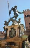 Neptune fountain, Bologna. The Neptune fountain in Pianna Maggiore, Bologna. Re Enzo palace in the background stock image