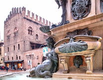 Neptune Fountain Bologna. Neptune fountain and Re Enzo Palace in Bologna , Italy Stock Images