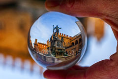 Neptune fountain in Bologna, in a crystal ball. Project crystal ball: tower of bologna royalty free stock image