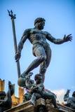 Neptune fountain. Bronze Neptune funtain in Bologna stock photos