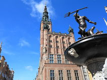 Neptune Fountain and city hall in Gdansk, Poland. Neptune Fountain and the Main Town Hall in city Gdansk - Poland Royalty Free Stock Images