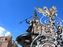 Neptune Fountain and city hall in Gdansk, Poland Royalty Free Stock Photography