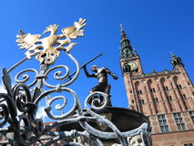 Neptune Fountain and city hall in Gdansk, Poland Royalty Free Stock Images