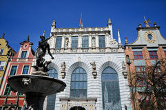Neptune fountain on Dluga street Gdansk. Neptune fountain surrounded by historical buildings in Old town of Gdansk on Dluga street stock photos