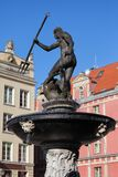 Neptune Fountain in City of Gdansk. Neptune Fountain Fontanna Neptuna in city of Gdansk, Poland. God of the Sea statue, cast from bronze in 1615 Stock Image