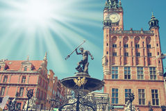 Neptune fountain in Gdansk. Famous part of old town in Gdansk with Neptune fountain  and city hall Royalty Free Stock Image