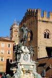 Neptune Fountain illuminated by the morning sun in the city center in Bologna in Emilia Romagna (Italy) Royalty Free Stock Images