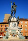 Neptune Fountain illuminated by the morning sun in the city center in Bologna in Emilia Romagna (Italy) Stock Photography