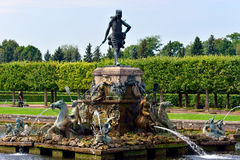 The Neptune Fountain in lower garden in Peterhof, Royalty Free Stock Image