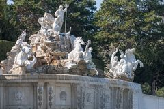 Neptune Fountain at Schonbrunn Palace, Vienna, Austria. Neptune fountain 1780 and the magnificent Schloss Schonbrunn Palace 1713 built for the Habsburg Dynasty Stock Image