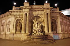Neptune Fountain, at night - attraction in Vienna, Austria. Stock Images
