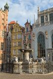 Neptune Fountain and old buildings in Gdansk. View of the Neptune Fountain in front of old historic buildings at Long Market Street Long Lane at the Main Town Stock Images
