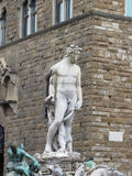 The Neptune fountain and Palazzo Vecchio in Florence, Italy . Detail of the Neptune statue . The Neptune fountain and Palazzo Vecchio in Florence, Italy Stock Photos