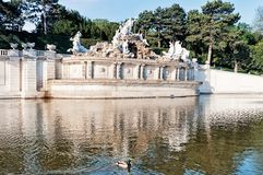 Neptune fountain in Schonbrunn palace, Vienna. The palace and gardens illustrate the tastes, interests, and aspirations of successive Habsburg monarchs Stock Images