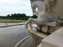 Neptune fountain Schonbrunn. View from Neptune fountain to the gardens at Sissy& x27;s Palace in Schonbrunn in Vienna Royalty Free Stock Photo