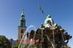 Neptune fountain and St. Mary Church Stock Images