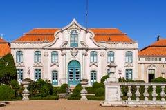 Neptune gardens (baroque) and one of the facades of the Queluz Royal Palace (Portugal). Stock Photos