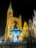 Neptune. Gdańsk, Poland - September 27, 2015:  Neptune statue in Gdansk at night lit by lights Stock Photos