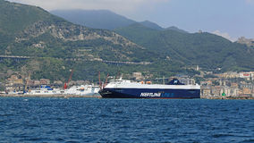 Neptune Lines. SALERNO, ITALY - JUNE 28: Neptune lines in Salerno on JUNE 28, 2014. Neptune Thelisis big car carrier RoRo ship leaving port in Salerno, Italy Royalty Free Stock Photo