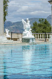 Neptune pool statue Royalty Free Stock Photography