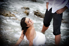 Neptunes bride (trash the wedding dress) Stock Images
