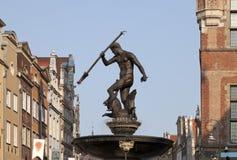 Neptune's Fountain in Gdansk, Poland. Neptune's Fountain, bronze statue of the Roman God of the sea in Gdansk, Poland Stock Photos