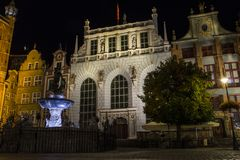 Neptune`s Fountain - is a historic fountain on the background of a beautiful old house in Gdansk at night. Poland stock photos