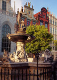 Neptune's fountain. Historic fountain with the figure of Neptune Long Market Street in a representative part of Gdansk Stock Images