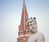 Neptune statue with bell tower Stock Image