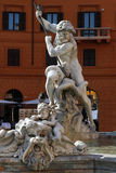 Neptune statue on the Fontana del Nettuno Stock Photos
