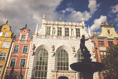 Neptune statue in Gdansk with colorful houses in the background, Stock Photo