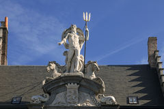 Neptune statue on the house Stock Images