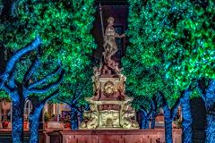 Neptune Statue at night with glow stock image
