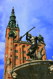 Neptune statue and Town hall. Neptune statue and fountain, dating from 1549, and the 16th century Town hall in Gdansk, Poland Stock Photos