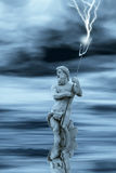 Neptune in water. God neptune while  hurls a lightning Stock Photo