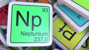 Neptunium Np block on the pile of periodic table of the chemical elements blocks. 3D rendering Stock Photography