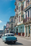 Neptuno street view with old car from Cuba Stock Photo