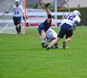 ner lacrossespelare Fotografering för Bildbyråer