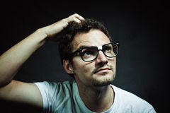 The Nerd. Nerd young guy wearing white t-shirt against a gray background stock image
