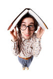 Nerd. Distorted image of a nerd holding a book over his head royalty free stock image