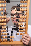 Nerd with abacus. Royalty Free Stock Photo