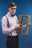 Nerd with abacus. Young nerd man holding abacus and pointing it Stock Photo