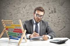 Nerd accountant does calculation of company revenue. Nerd accountant does complex calculation of company revenue stock photos