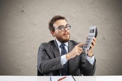 Nerd accountant does calculation of company revenue. Nerd accountant does complex calculation of company revenue royalty free stock images