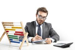 Nerd accountant does calculation of company revenue. Nerd accountant does complex calculation of company revenue royalty free stock image