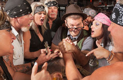 Nerd Beats Biker in Arm Wrestling Stock Photo